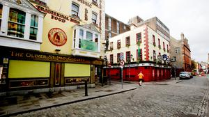 SHUTDOWN: Pubs in Temple Bar, Dublin, boarded up their windows following a spate of targeted raids by gangs. Photo: Sam Boal