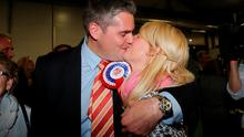 DUP's Gavin Robinson kisses his wife Lindsay after winning the East Belfast parliamentary seat at the Kings Hall in Belfast. Photo: Niall Carson/PA Wire