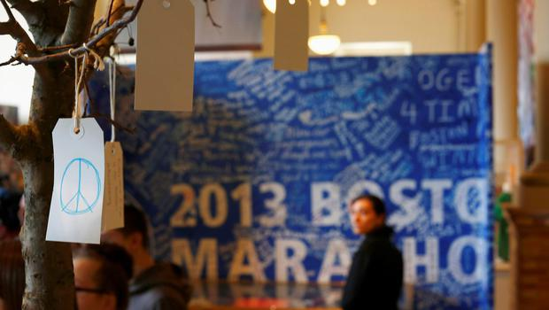 A peace sign is seen on a message tree as visitors look at artefacts in a public exhibition of objects and mementos left at the makeshift memorials that emerged in the aftermath of the Boston Marathon Bombings in Boston, Massachusetts, April 7, 2014. REUTERS/Dominick Reuter