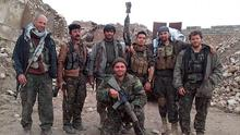 Kurdish fighters and foreign volunteers fighting together against the against the Islamic State group, including American citizen Jordan Matson, second right, Australian citizen volunteer Ase Johnson, right, and British citizen Konstandinos Erik Scurfield, foreground (AP Photo courtesy Jordan Matson)