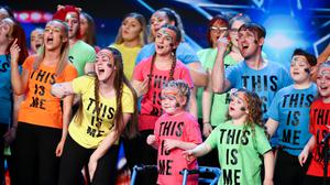Ella (front centre) performing with the choir (Syco/Thames/ITV)