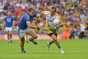 Donegal's Karl Lacey battles past Eoin Brosnan of Kerry during one of the Kingdom's recent high-profile defeats to Ulster sides in the All-Ireland. Photo: Barry Cregg / SPORTSFILE