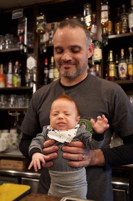 Baby steps: Will Ryan, co-owner of Irish bar An Sólás in Tokyo, with his first child, who was born in December