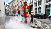 A City of London worker cleans pavements on Lombard Street in the City of London, after the Prime Minister Boris Johnson said people who cannot work from home should be 'actively encouraged' to return to their jobs. Photo: Kirsty O'Connor/PA Wire