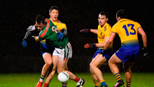 Diarmuid O'Connor of Mayo in action against Roscommon players, from left, Ronan Daly, Conor Hussey and Donie Smith