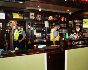 Gardai leaving Whelans Pub in Newcastle west, Co                   Limerick. Picture Brendan Gleeson