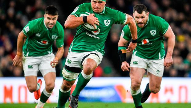 CJ Stander makes a break with the support of his Ireland team-mates Conor Murray, left, and Cian Healy, right