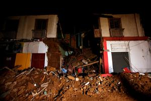 Debris of a destroyed house sit on a street in Illapel, Chile, Thursday, Sept. 17, 2015. A magnitude 8.3 earthquake hit off northern Chile on Wednesday night, causing buildings to sway in the capital of Santiago and prompting authorities to issue a tsunami warning for the Andean nation's entire Pacific coast. People sought safety in the streets of inland cities, while others along the shore took to their cars to get to higher ground. (AP Photo/Luis Hidalgo)