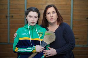 Life of pain: Amy Lynam (12) with her mother Pam, who says she is dreading what will happen to her daughter's care. Photo: Mark Condren
