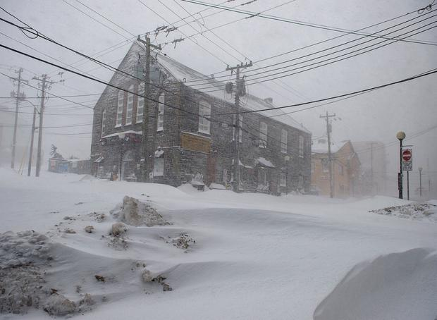 The streets were quiet St. Johnâ Newfoundland on Friday, Jan. 17, 2020, as a major winter storm brought the city to a standstill. The city has declared a state of emergency, ordering businesses closed and vehicles off the roads as blizzard conditions descend on the Newfoundland and Labrador capital. (Andrew Vaughan/The Canadian Press via AP)
