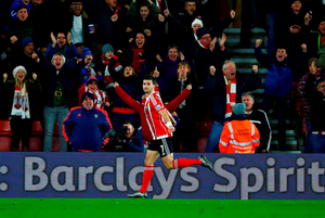 Shane Long celebrates his goal for Southampton during their victory over Arsenal at St Mary's. (Photo by Christopher Lee/Getty Images)