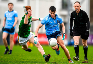 Lorcan O'Dell of Dublin in action against James O'Hare of Meath. Photo by David Fitzgerald/Sportsfile