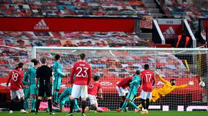 Bruno Fernandes of Manchester United scores the winner past Alisson Becker in the Liverpool goal. (Photo by Laurence Griffiths/Getty Images)