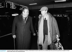 Jack Charlton, accompanied by Joe Delaney, assistant honorary treasurer of the FAI, arrives at Dublin airport four days after his appointment as Republic of Ireland manager. Dublin. Photo by Ray McManus/Sportsfile