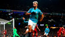 First class: Sergio Aguero celebrates after opening the scoring against Liverpool in Manchester City's victory last night. Photo: Clive Brunskill/Getty Images