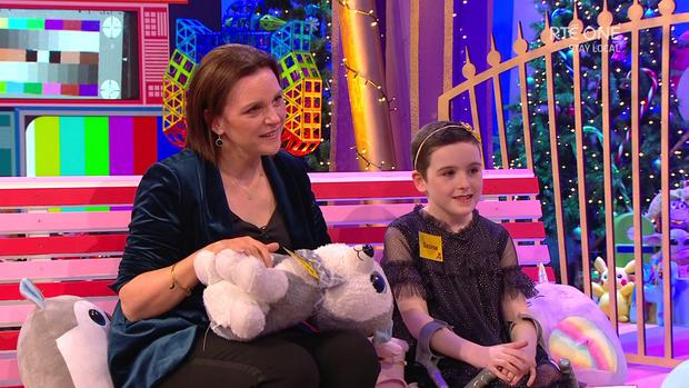 DREAMS: Saoirse with her mum Roseanna. The eight-year-old, who lost a leg due to a tumour, was gifted a Disney World trip