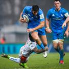 Leinster's Ross Byrne is tackled by Benetton's Monty Ioane. Photo: Ramsey Cardy/Sportsfile
