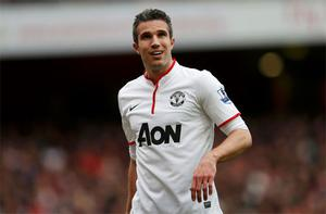 Manchester United's Robin van Persie reacts after the Premier League match against Arsenal at the Emirates