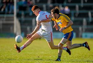 Cathal McShane, Tyrone,  under pressure from Cathal Kenny