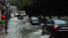 Heavy Rain and backlash of water through man holes flood Templeshannon Quay (stock photo)