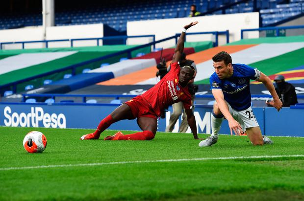 MAN OF THE MATCH: Everton's Seamus Coleman keeps Sadio Mane under wraps at Goodison Park. Pic: Peter Powell/PA Wire/NMC Pool.