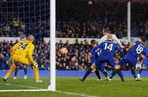 Dynamo Kiev's Oleg Gusev flicks his side in front from a near post corner