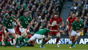 Wales's Andrew Coombs is tackled by Ireland's Conor Murray
