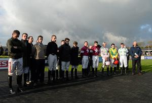 Jockeys stand to observe a minutes silence after the death of former jockey and trainer Dessie Hughes. Punchestown Horse Racing - Winter Festival, Punchestown, Co. Kildare. Picture credit: Barry Cregg / SPORTSFILE