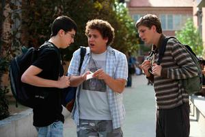 Christopher Mintz Plasse, pcitured with Jonah Hill and Michael Cera, as McLovin' in Superbad