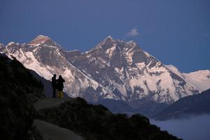Travellers enjoy a view of Mount Everest at Syangboche in Nepal
