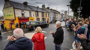 Respect: The remains of John Hume are brought through the streets of Derry yesterday. Pic: Mark Condren