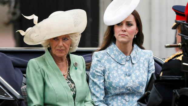 Britain's Catherine, the Duchess of Cambridge (R) and Camilla the Duchess of Cornwall