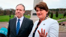 DUP leader Arlene Foster and deputy leader Nigel Dodds speaking to the media outside Stormont. Photo: Niall Carson/PA Wire