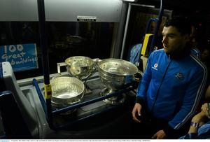 23 September 2013; Dublin's Paddy Andrews on the team Dublin bus with the Sam Maguire and Leinster cups during the homecoming celebrations of the All-Ireland Senior Football Champions. Merrion Square, Dublin. Picture credit: David Maher / SPORTSFILE