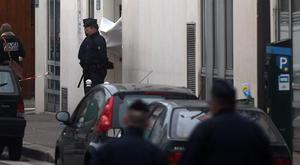 PARIS, FRANCE - JANUARY 07:  Police officers guards the offices of the French satirical newspaper Charlie Hebdo on January 7, 2015 in Paris, France. Armed gunmen stormed the offices leaving twelve dead, including two police officers, according to French officials.  (Photo by Antoine Antoniol/Getty Images)