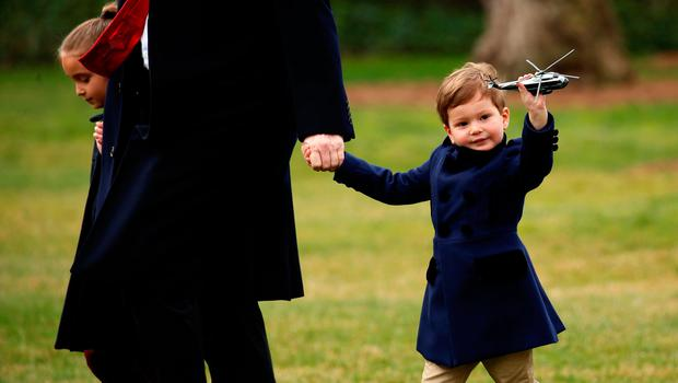 Joseph Kushner holds up a toy Marine One as his grandfather, U.S. President Donald Trump, holds hands with him and his sister Arabella as they depart aboard Marine One from the White House in Washington, U.S. March 3, 2017.  REUTERS/Kevin Lamarque      TPX IMAGES OF THE DAY