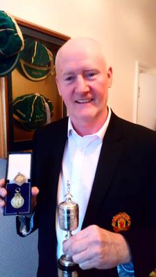 Ashley Grimes with his FAI Cup, FA Cup and English League Cup medals