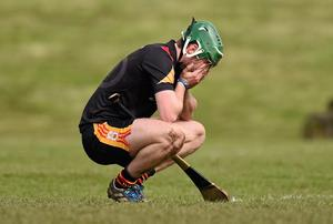 Ard Scoil Rís player Ronan Lynch dejected after losing a game