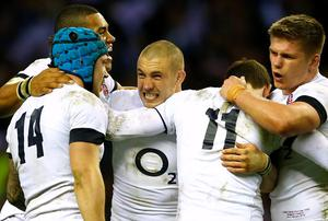 England's Mike Brown celebrates with teammates after defeating Ireland in their Six Nations Championship rugby union match at Twickenham