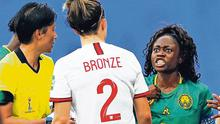 Heat of Battle: Cameroon's Gabrielle Aboudi Onguene makes her point to England's Lucy Bronze as referee Qin Liang looks on. Photo: Phil Noble/Reuters