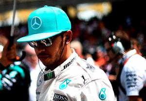 Lewis Hamilton of Great Britain and Mercedes GP prepares on the grid before the Malaysia Formula One Grand Prix