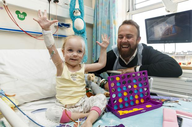 All smiles: Alana Brennan (3) from Coolock, Dublin, meets golfer and 2019 Open champion Shane Lowry at Temple Street as he was announced as an official ambassador for the hospital. Photo: Andres Poveda