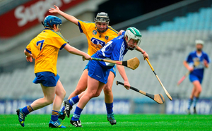 Laura Marie Maher of Laois, attempts to drive through Joanne Beattie, left, and Niamh Coyle, Roscommon