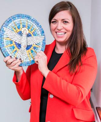 Carol McGowan with one of her mosaic headstones