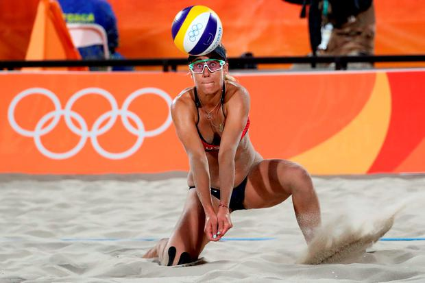 April Ross of United States bumps the ball during the Women's Beach Volleyball preliminary round Pool C match against Fan Wang and Yuan Yue of China on Day 3 of the Rio 2016 Olympic Games at the Beach Volleyball Arena on August 8, 2016 in Rio de Janeiro, Brazil. (Photo by Ezra Shaw/Getty Images)