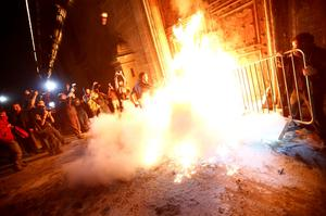 A group of protesters set fire to the wooden door of Mexican President Enrique Pena Nieto's ceremonial palace, during a protest denouncing the apparent massacre of 43 trainee teachers