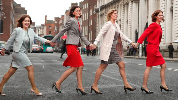 Fine Gael TDs Josepha Madigan, Kate O'Connell, Maria Bailey and Hildegarde Naughton make their way back to Government Buildings following a Fine Gael International Women's Day photocall. Photo: Gerry Mooney