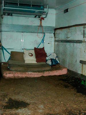 The interior of a squalid shipping container where kidnapped cattle dealer Paul Gogan was held hostage Credit: PSNI/PA Wire