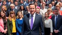 UK Prime Minister David Cameron, centre, poses for a group photo with newly elected Conservative MPs at the Houses of Parliament in central London. Photo: Getty Images