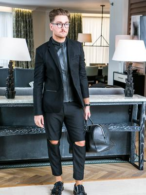 Rob Kenny wears a Blazer, The Kooples at Brown Thomas; trousers, COS (with knee patch added by The Zip Yard); shoes, Hudson London; bag, Sandra Paris; watch, Daniel Wellington; glasses, Specsavers. Picture: Kyran O'Brien
